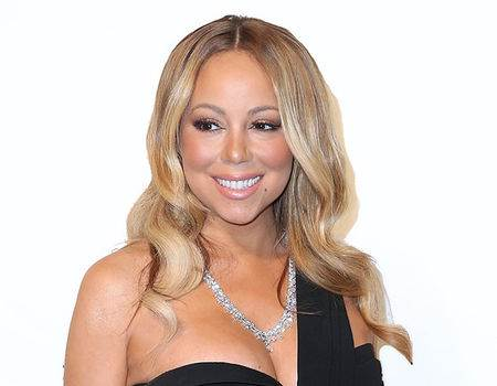 Mariah Carey Shows Ample Cleavage While ''Festivating'' in