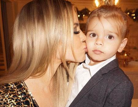 Khloe Kardashian's Christmas Eve Kiss to Reign Disick May Be the