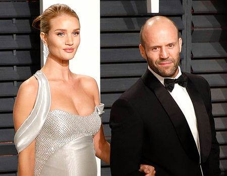 Pregnant Rosie Huntington-Whiteley Shines Next to Jason Statham at the Vanity