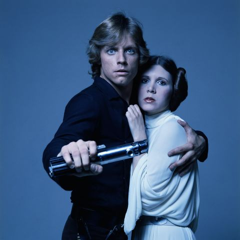 mark hamill and carrie fisher in costume as brother and sister luke skywalker and princess leia in george lucas' star wars
