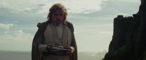 luke skywalker holding his lightsaber