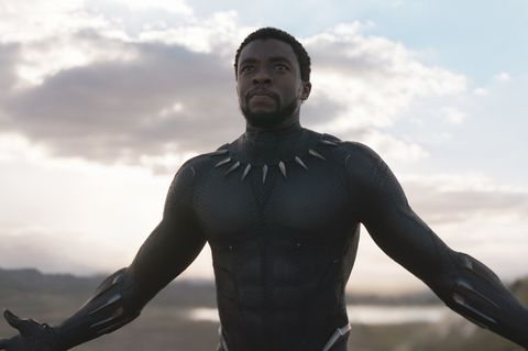 chadwick boseman as t'challa in black panther suit with arms open