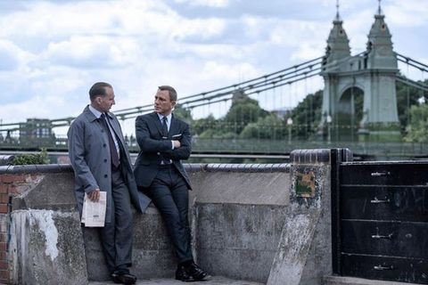 james bond no time to die   daniel craig and ralph fiennes in front of westminster bridge